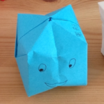 origami box in blue with eyes